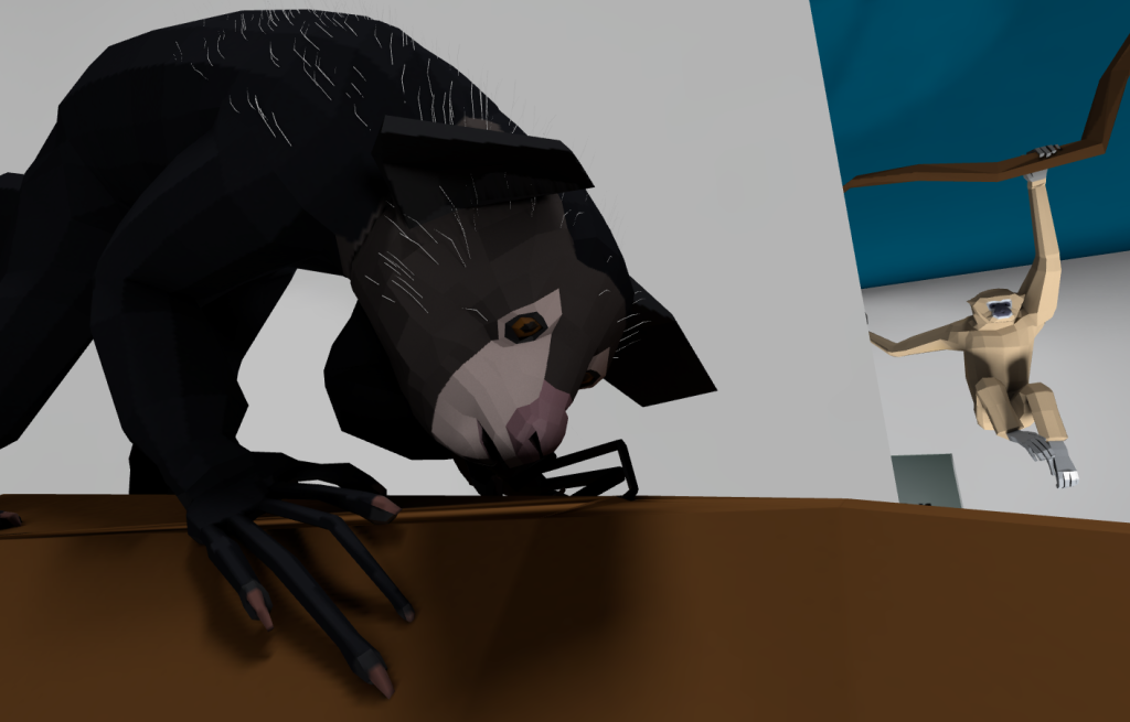 Closeup of the aye-aye model with the gibbon in the background.