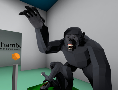 Models of chimpanzees displaying and cracking nuts